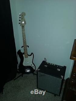 Bass Guitar, amplifier, tuner and cable