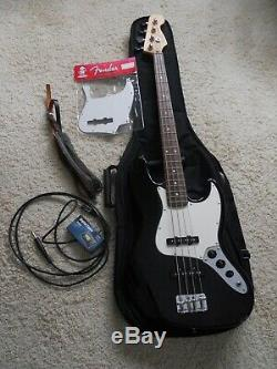 Fender Jazz Bass 4 string electric guitar, withExtra's, case, tuner, strap, & cord